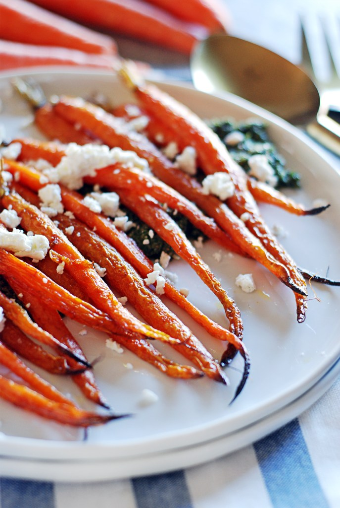 This recipe for oven roasted carrots will be the last one you ever need - paired with pesto made from the carrot tops and goat cheese.