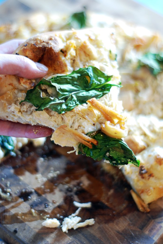 This delicious garlic butter pizza features shredded chicken, spinach, and mozzarella.