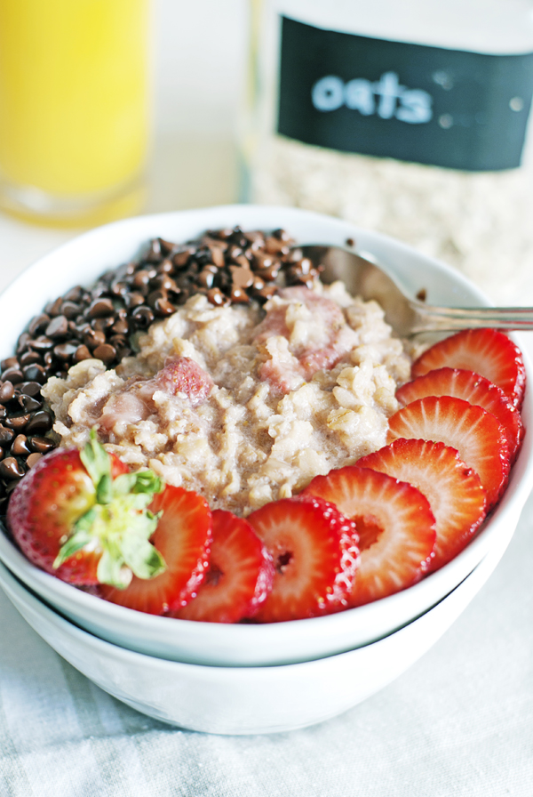 This quick strawberry oatmeal is the perfect solution for a healthy breakfast, and features mini chocolate chips, fresh and frozen strawberries, and honey.