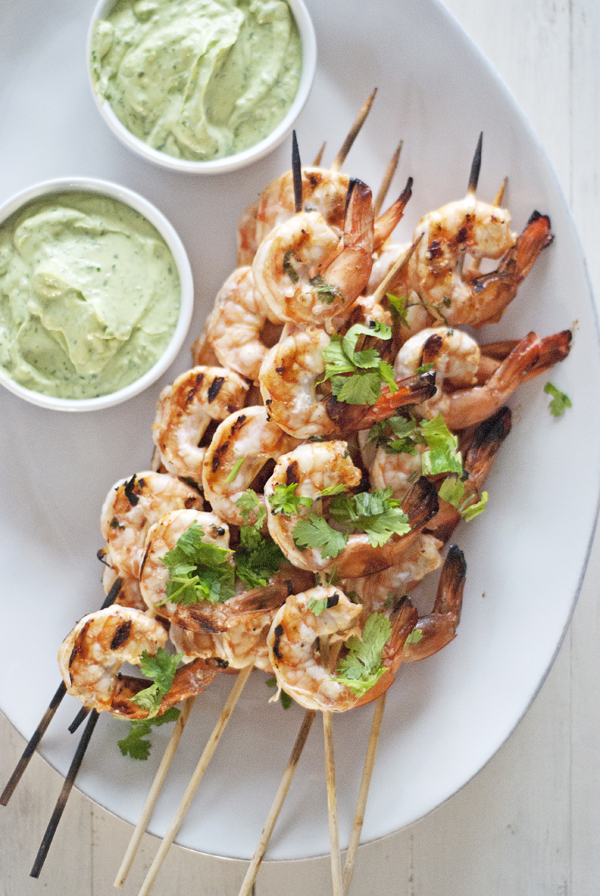These spicy grilled shrimp are paired with a creamy avocado and Greek yogurt dipping sauce. They make a great, easy weeknight meal and are ready in just 35 minutes!