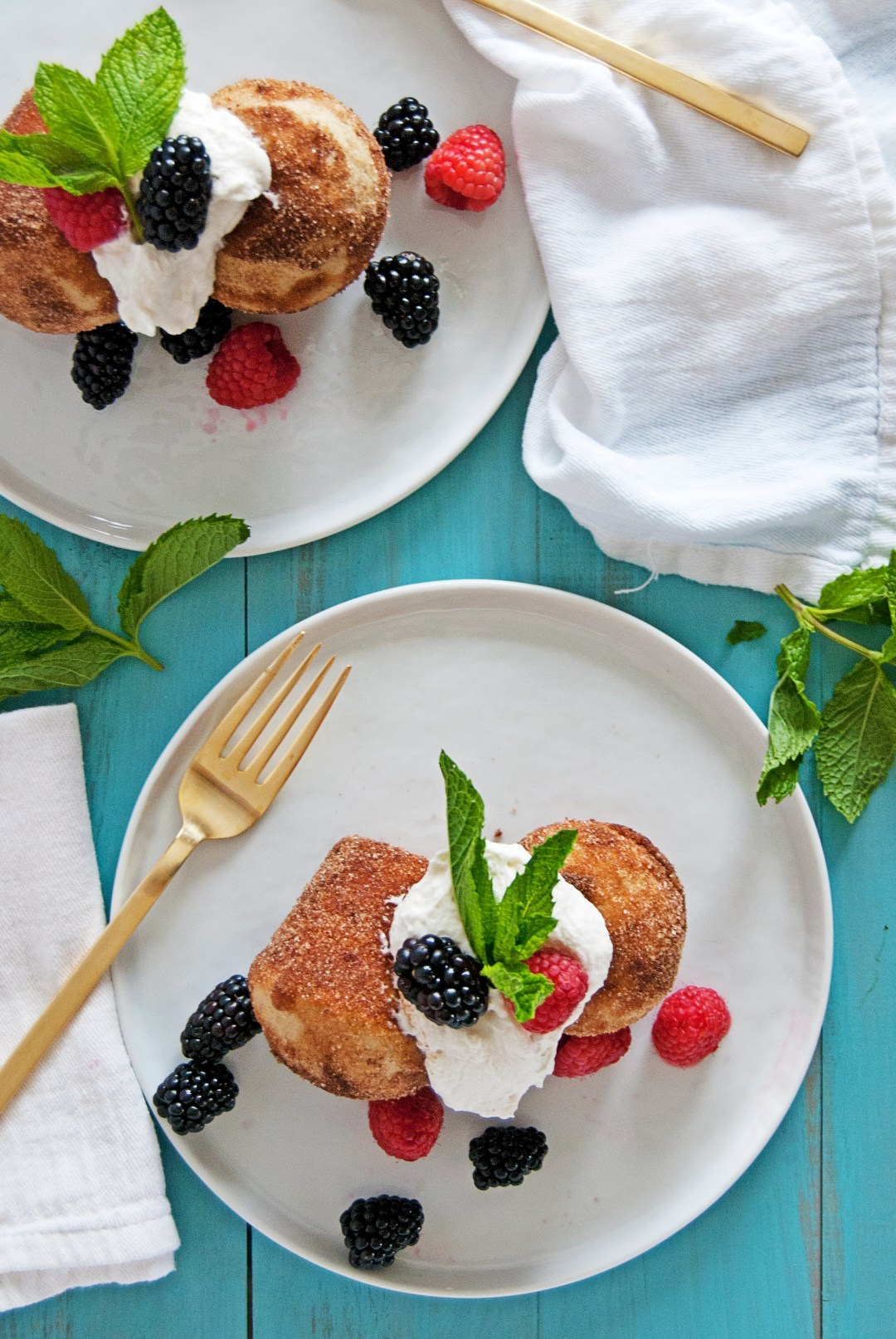 These tasty French breakfast puffs are paired with a fluffy homemade whipped cream and fresh blackberries and raspberries, for a tasty breakfast!