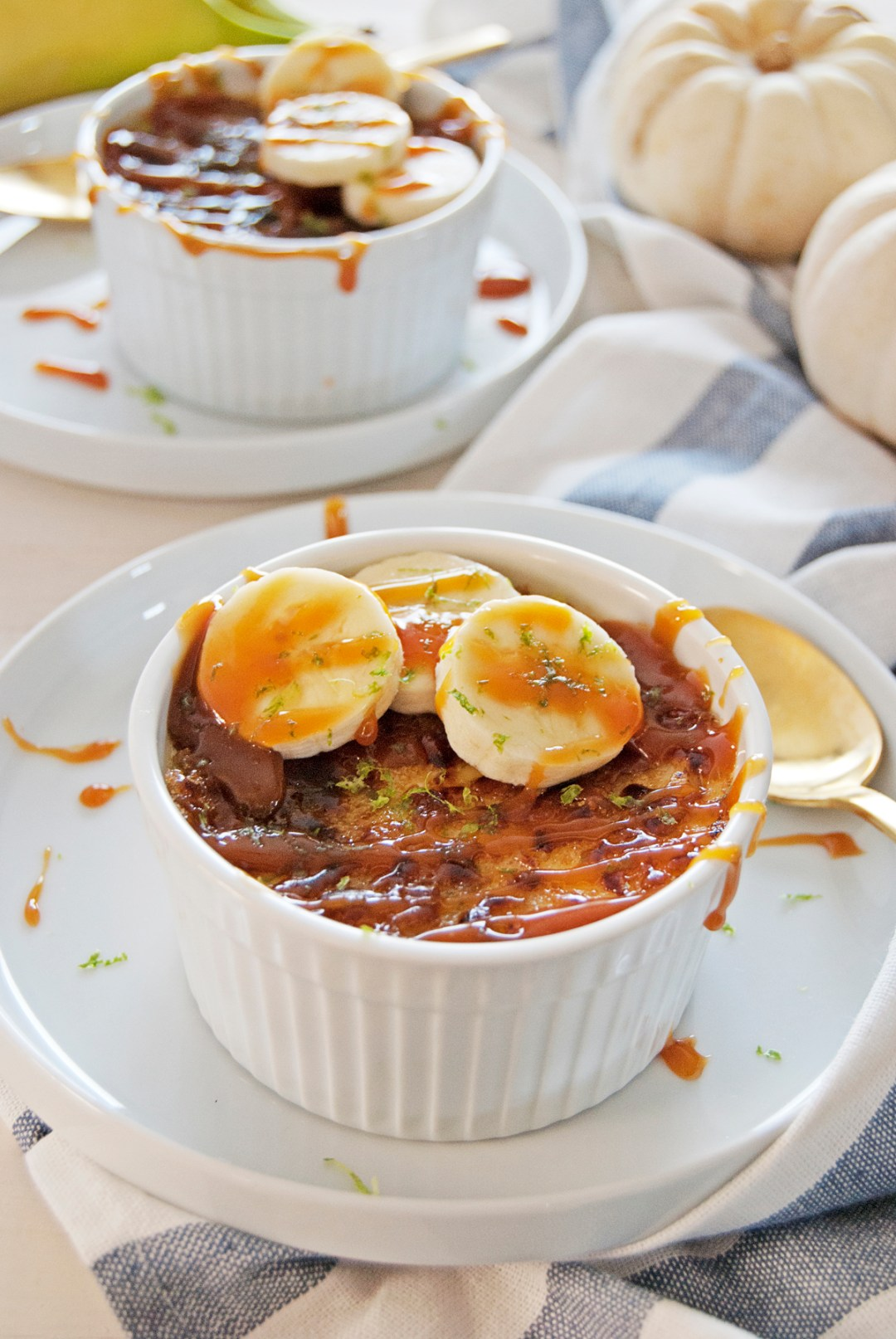 This banana creme brulee features a creamy creme brulee base with fresh bananas and a rum caramel sauce.