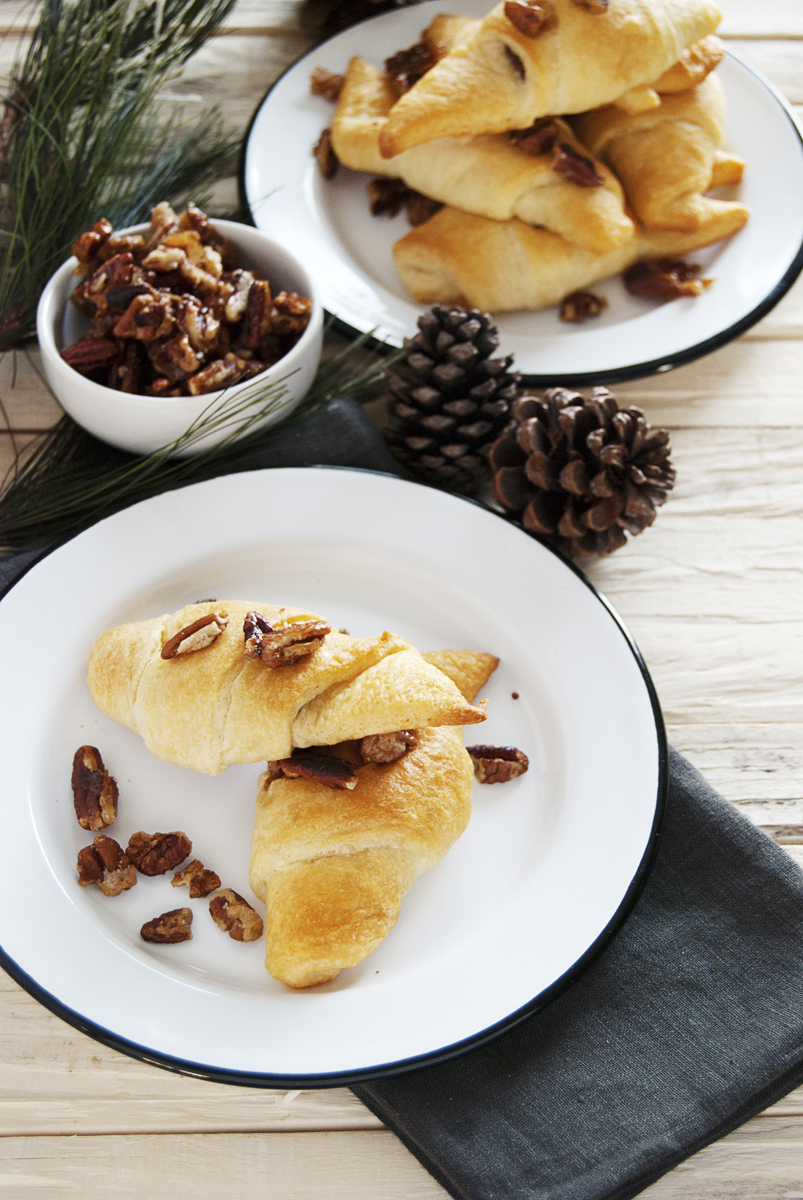 These tasty chocolate crescent rolls are filled with milk chocolate and topped with a quick candied pecan. They are the perfect simple dessert for the winter!