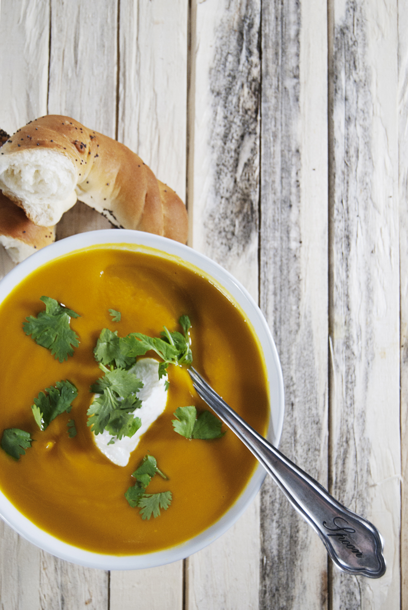 This will be your new favorite butternut squash soup recipe! Featuring a host of tasty Asian inspired flavors, this butternut squash soup is paired with a ricotta crema and fresh cilantro too.