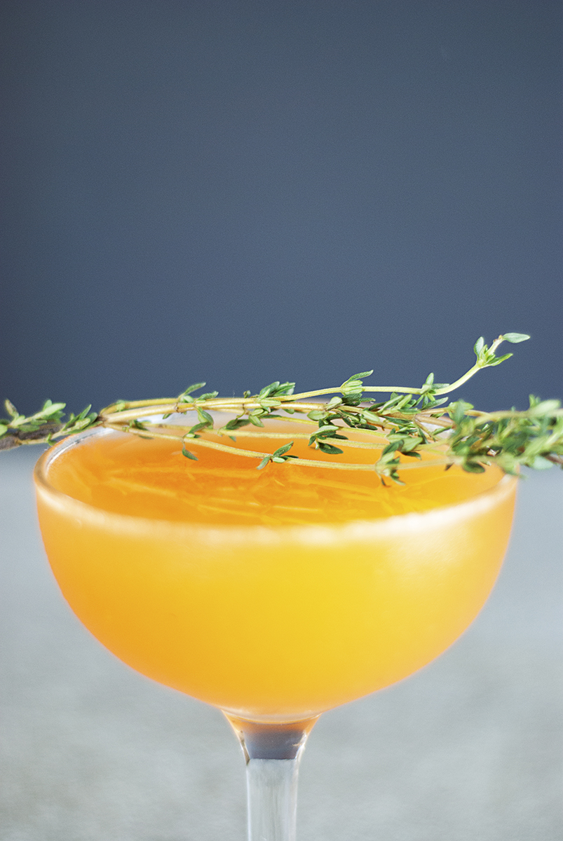 A tart and refreshingly spring cocktail that mixes bourbon with fresh clementine juice, honey, and thyme.