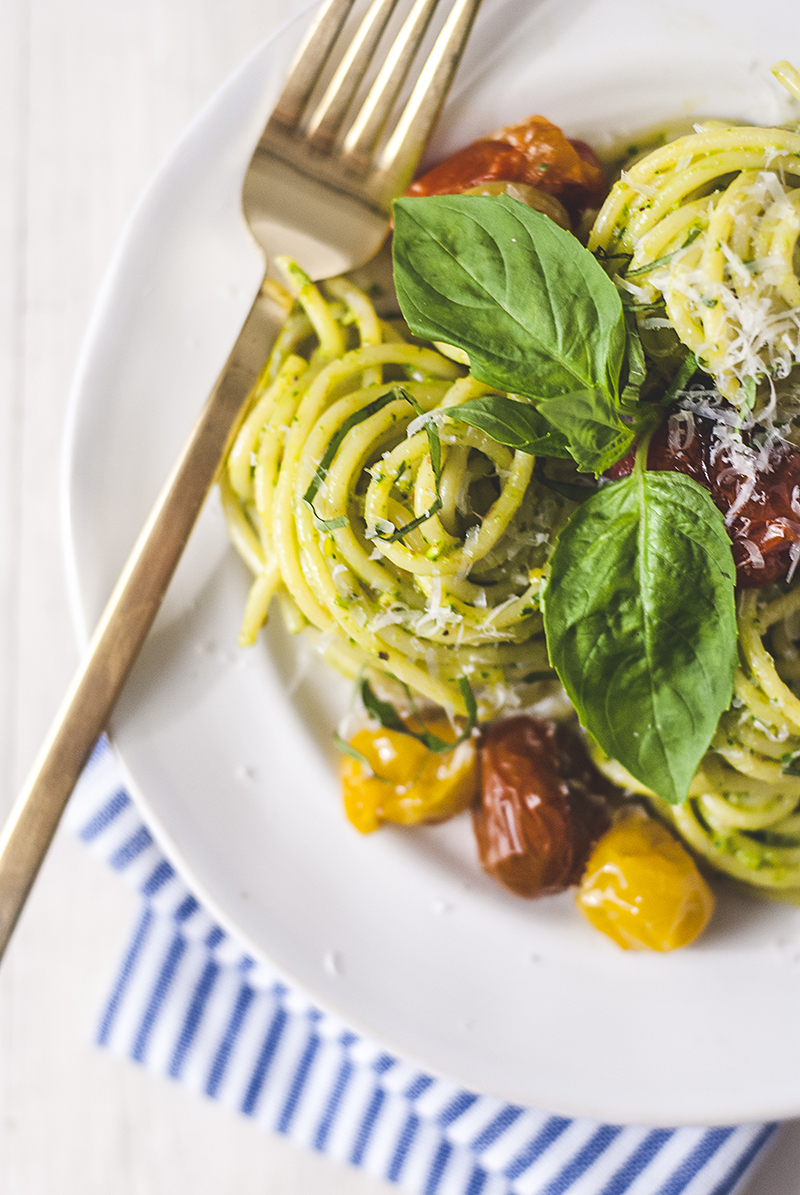 This spaghetti with burst tomatoes is the perfect answer to the question of what to cook on those hot summer nights that is simple, refreshing, and exploding with flavor. Roasted cherry tomatoes are paired with a pistachio pesto for a new twist on a classic dish.