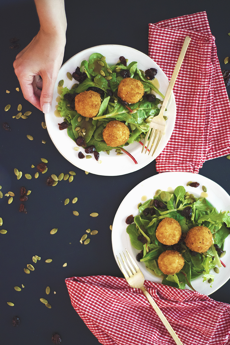 This fried goat cheese salad is the tastiest side salad ever! It features deep fried goat cheese balls, pepitas and cranberries with a simple vinaigrette.