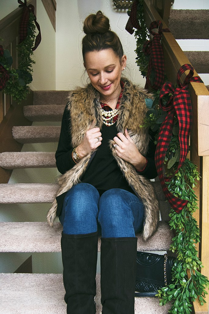 This faux fur vest outfit is the perfect look for your next holiday party! Paired with plaid, a cashmere sweater, and suede boots, it's the perfect way to stay warm and look chic this season!