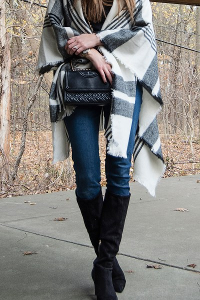This plaid poncho wrap is the absolute perfect layering piece for the winter! It's comfy and cozy, and perfect to pair with a pair of suede boots and a hat!
