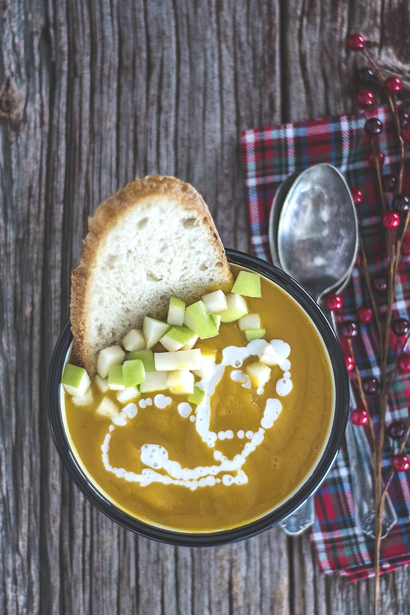This butternut squash and apple bisque is quick, easy, and has allll the fall flavors! Serve with crusty bread and a coconut crema for a tasty winter meal!