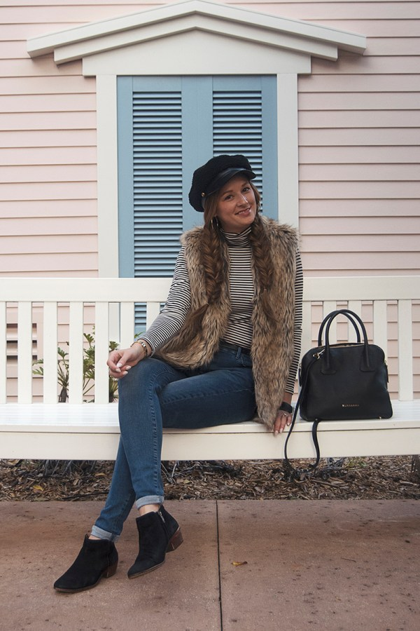 Today I'm sharing my holiday Walt Disney World OOTD, complete with my new favorite fur vest, baker boy hat, and stripes!