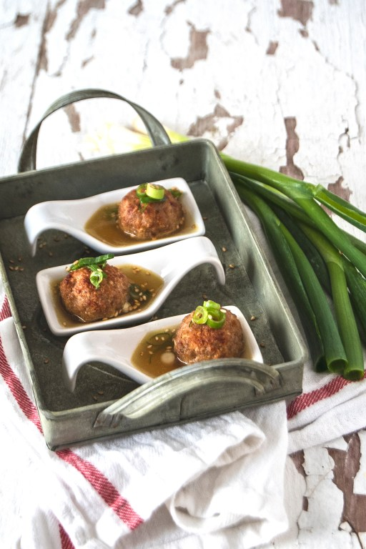 These Asian style meatballs are the perfect unique party hors d'oeuvres or appetizer! They are served in a quick delicious broth with scallions.