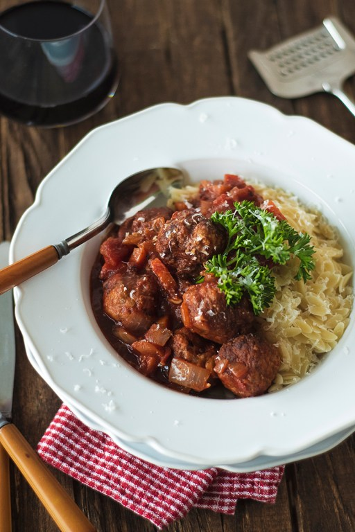 This hearty tomato lamb meatball stew comes together in under an hour with the assistance of an InstantPot, and is paired with orzo and lots of parm!