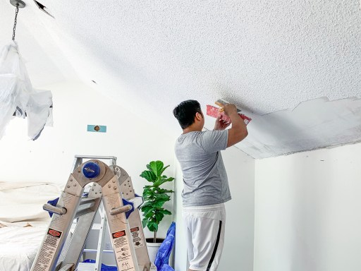 Over the past few months we have slowly done our own DIY removal of our outdated popcorn ceilings, and today I'm sharing our how to remove popcorn ceilings DIY step-by-step guide!