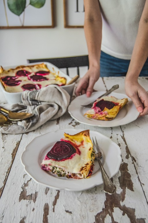 This vegetarian roasted beet lasagna is so hearty and comforting that you won't miss the meat! It features roasted beets and a creamy asparagus and pea filling.