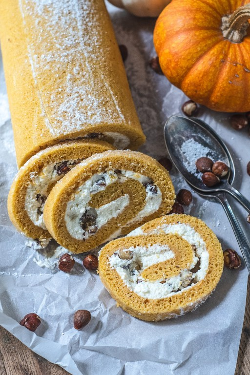 Today's recipe is a delicious pumpkin roll with white chocolate mousse and hazelnuts, and it does not disappoint! Grab this recipe for a tasty dessert to take to your next holiday party!