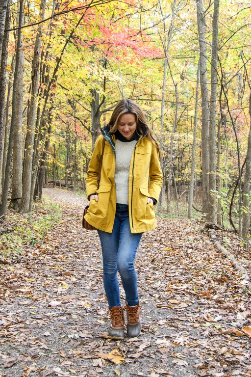 This yellow raincoat outfit is the perfect look for rainy autumn weather! Paired with plaid, a cozy sweater, and the quintessential L.L. Bean boots, it's a go-to outfit this season!