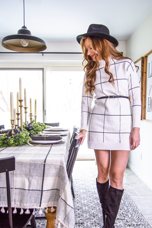 This chic black and white grid plaid sweater dress is the perfect chic outfit for Thanksgiving, and works great with a black felt hat and suede boots!