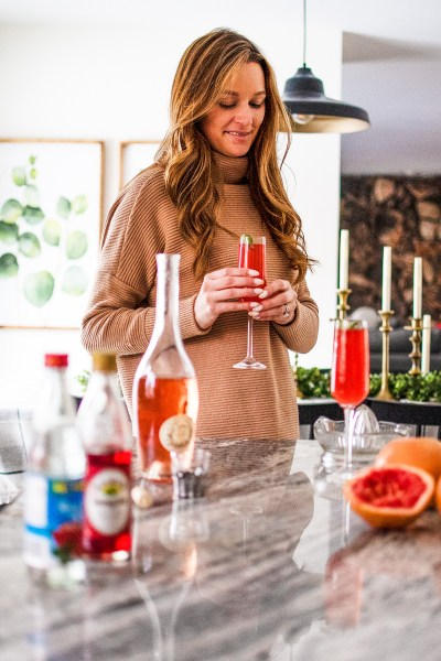 Celebrate Valentine's Day with a tasty and refreshing cocktail that is totally color-appropriate: this rosé and grapefruit spritzer is perfect for celebrating!
