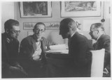 Le Corbusier sitting with Soviet modernist architect Andrei Burov (1928)