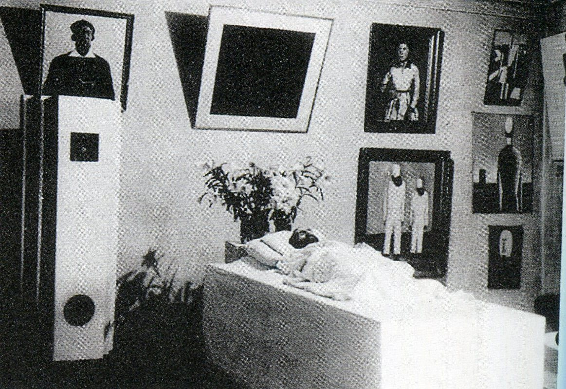 Malevich in his deathbed, surrounded by his works (1935)