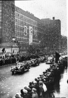 Parade in front of Corbusier's Tsentrosoiuz building in Moscow, 1938