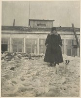 Johan Niegeman's wife Gerda Marx with Pitt the dog in front of the foreign specialists' barracks (1931)