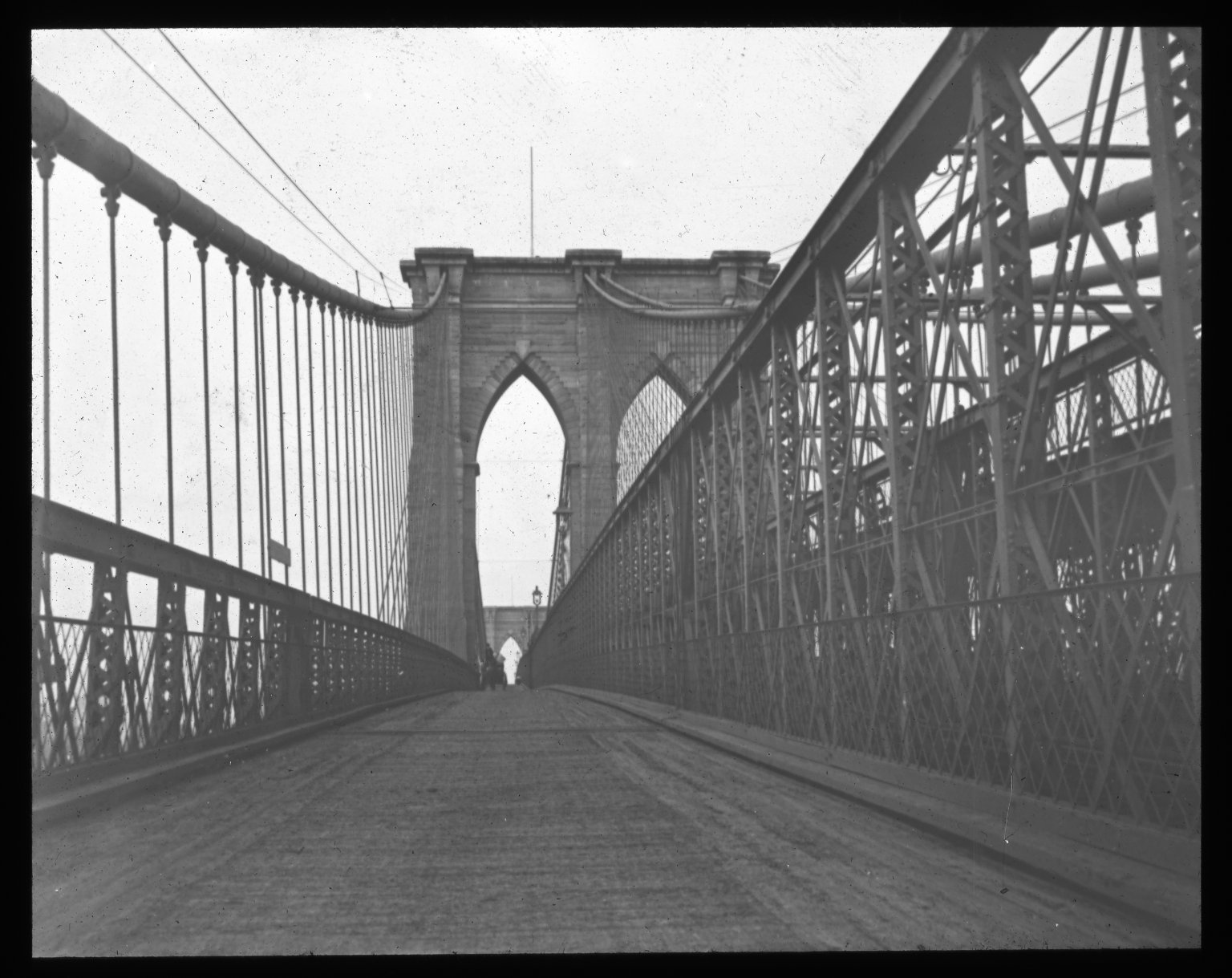 Looking to the carriage-way; from Brooklyn tower. Collection- Lantern Slide Collection Views- U.S., Brooklyn Brooklyn Bridge 1896-1900