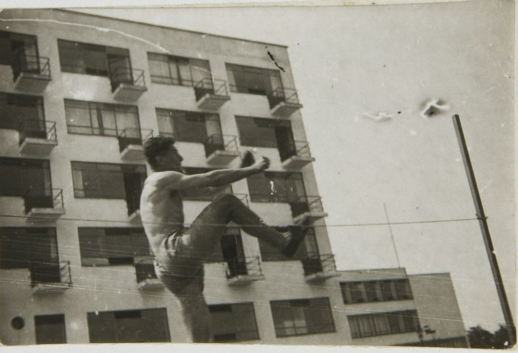 Unidentified Artist High-Jumper in front of the Studio Building at the Bauhaus, Dessau, 1930 Photograph German, 20th century Gelatin silver print image- 2.4 x 3.6 cm (15:16 x 1 7:16 in.)