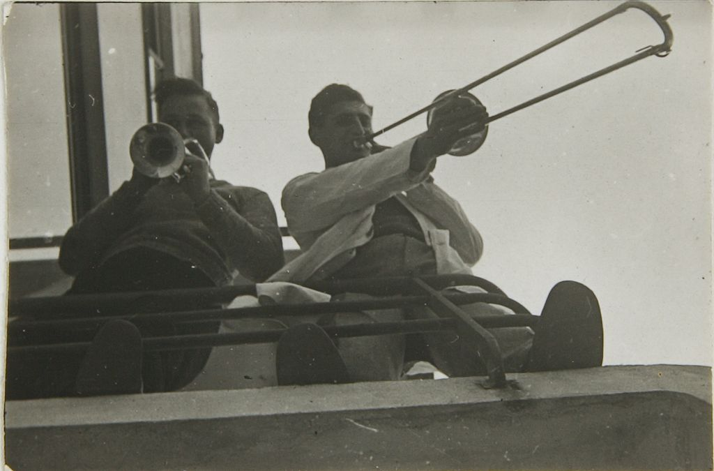 Unidentified Artist Two Members of the Bauhaus Band on the Balcony of the Studio Building, c. 1930 Photograph German, 20th century Gelatin silver print image- 2.5 x 3.6 cm (1 x 1 7:16 in.)