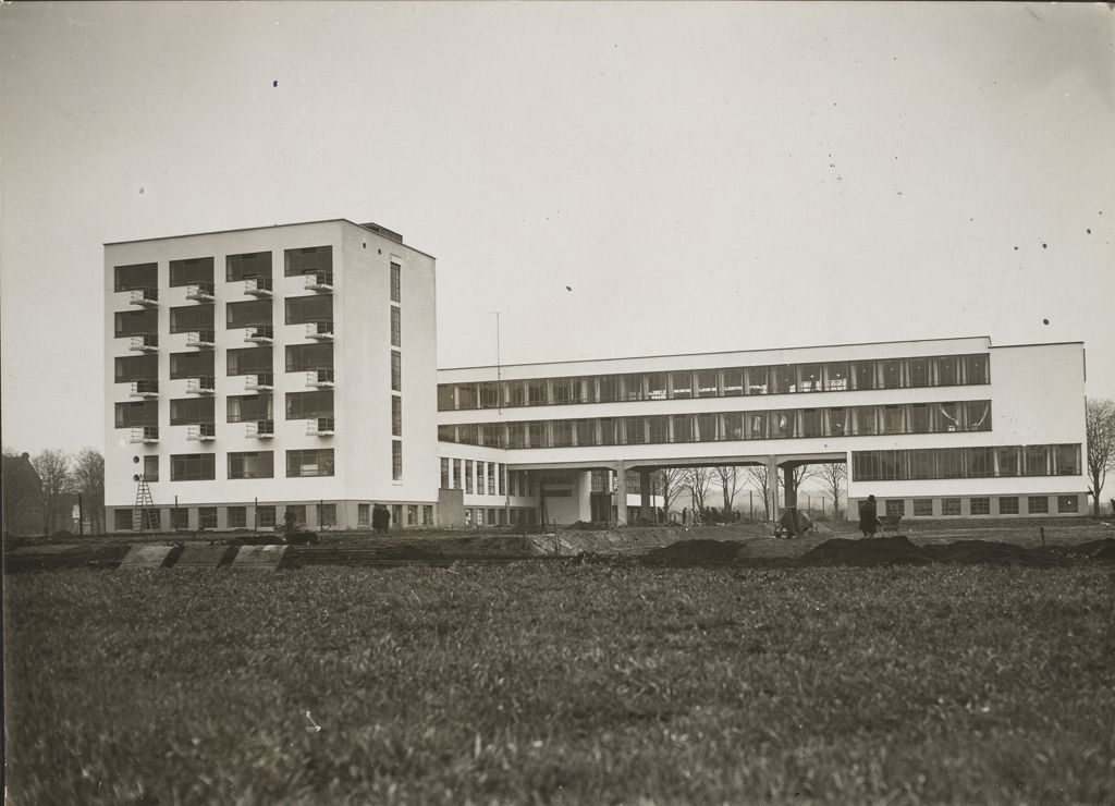 Unidentified photographer Bauhaus Building, Dessau, 1925-1926- View from northeast before completion [architect- Walter Gropius], c. 1926 Gelatin silver print sheet- 11.9 x 16.5 cm