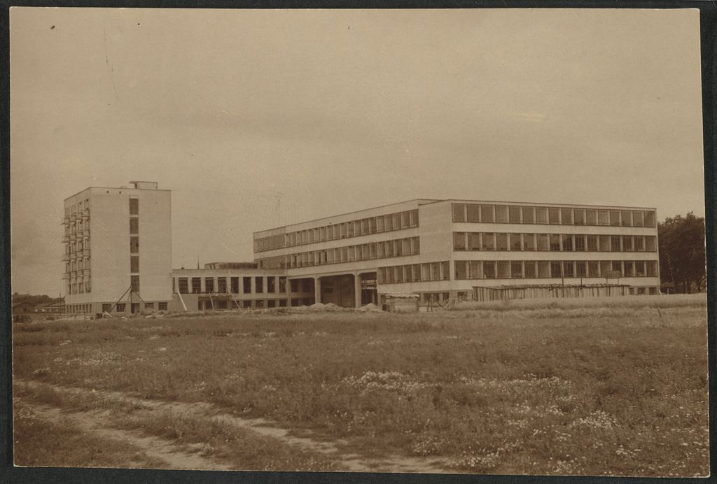 Unidentified photographer Bauhaus Building, Dessau, 1925-1926- View from northeast before completion [architect- Walter Gropius], c. 1926 Gelatin silver print sheet- 7.1 x 10.6 cm