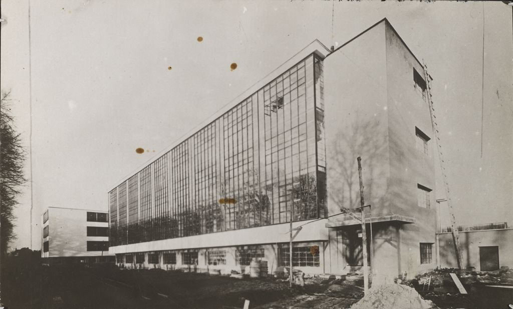 Unidentified photographer Bauhaus Building, Dessau, 1925-1926- Workshop wing before completion, view from southwest [architect- Walter Gropius], c. 1926 Gelatin silver print sheet- 5.3 x 8.7 cm