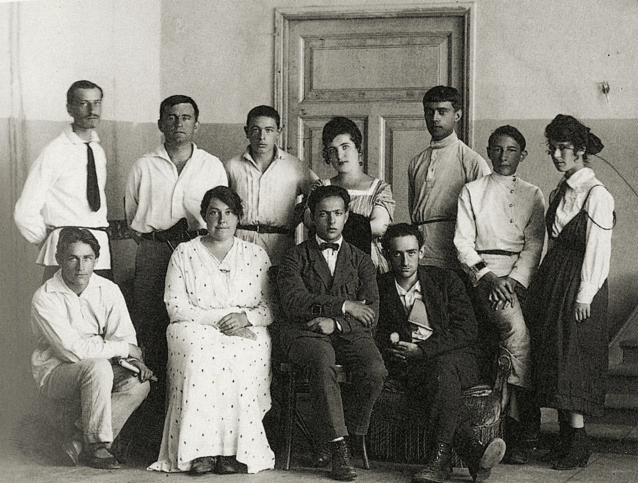 Left-to-right, standing- I.Chervinko, K.Malevich, T.Royak, A.Kagan N.Suetin, L.Yudin, E.Magaril; seated- M.Vexler, V.Ermolaeva, I.Chashnik, L.Khidekel11