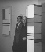 (Image- from left to right- Harry Holtzman standing with Piet Mondrian, Holtzman's studio, New York City, 1941