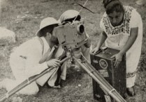 Eisenstein looking into the finder to gauge an angle closeup of a Mexican woman