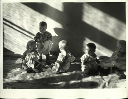 Margaret Bourke-White, Russian toddlers under daycare at nursery in Auto Plant while their mothers work on an assembly line (Ge