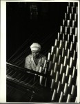 Margaret Bourke-White, Russian woman working at cloth weaving machine in a textile mill (1930)