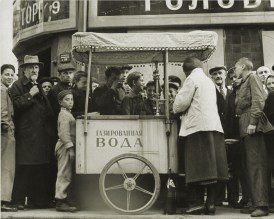 Margaret Bourke-White, Woman street vender selling fruit & water fr. her cart on Kusnetsky St (Moscow, 1941)