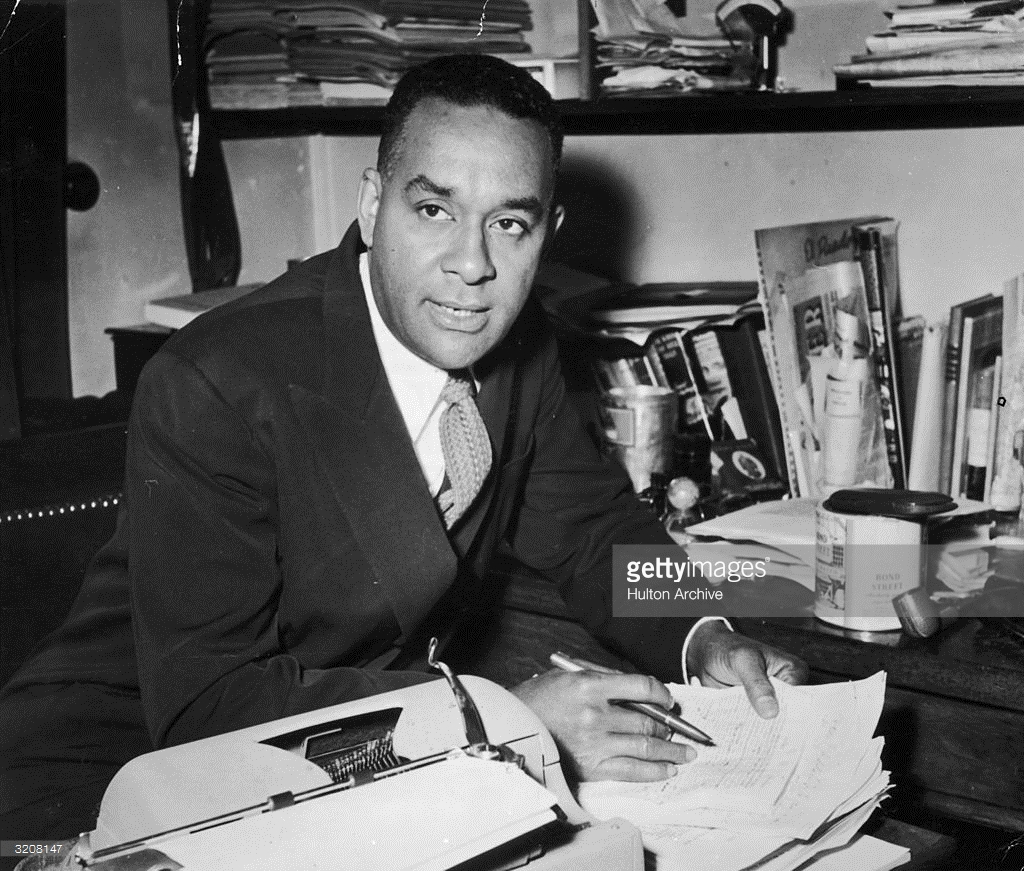 10th-october-1957-american-author-richard-wright-sits-at-a-desk-with-a-pen-in-his-hand-shortly-before-the-publication-of-his-book-white-man-listen-paris