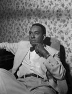 american-author-richard-wright-sitting-on-a-sofa-lido-venice-1950
