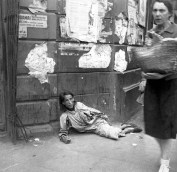 A woman lying on the pavement in the Warsaw ghetto, starving to death, 1941