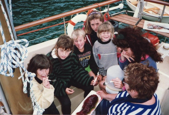 Children gathered in cockpit of yacht