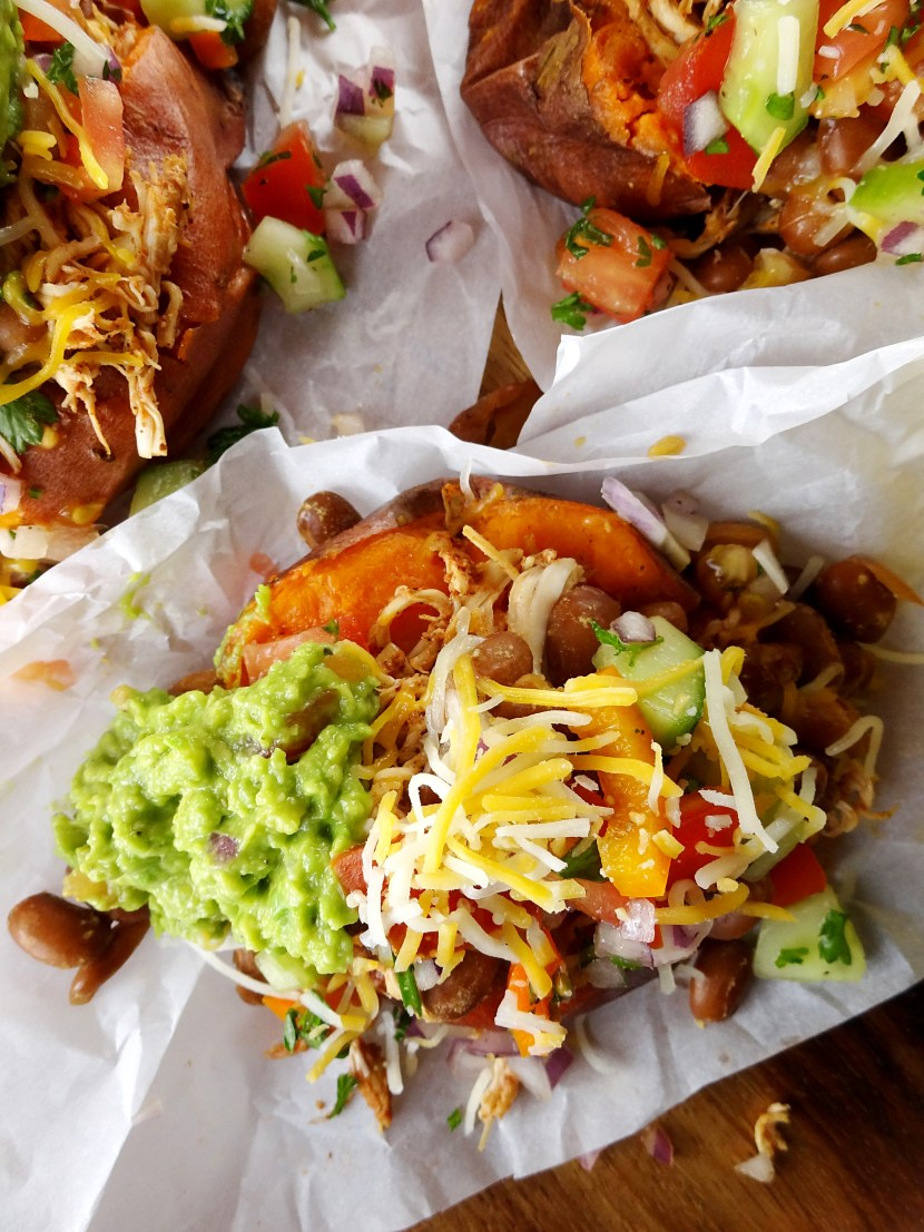 Chicken Taco Baked Sweet Potatoes with slow cooker chicken! Recipes for pico de gallo & guacamole too. The Cheerful Kitchen.