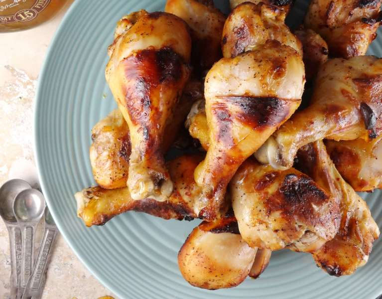 Whiskey + Honey Baked Drumsticks are so easy and the perfect party food! Game day won't be the same without them. From The Cheerful Kitchen.