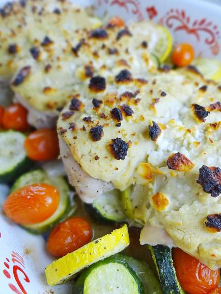 One Pan Hummus Chicken + Veggies with Feta is a no muss, no fuss dinner for the whole family! One pan to clean, that's it. From The Cheerful Kitchen