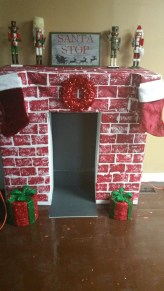 Fireplace out of boxes, craft paper and paint