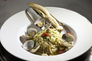 Home-made linguine with razor clams, manila clams, cherry tomatoes and parsley