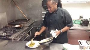 Chef Brandon Walker cooking