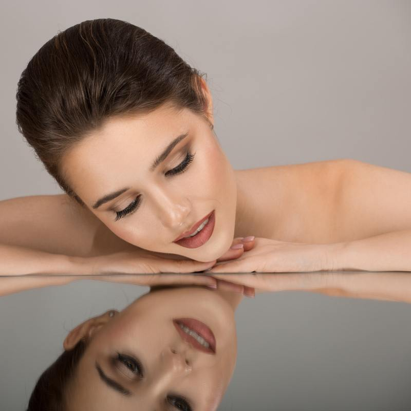 Beautiful Woman And Her Reflection. Perfect Skin.